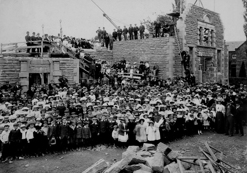 Historic photograph showing view of crowd in front of the Phipps Institute, Beauly, under construction.