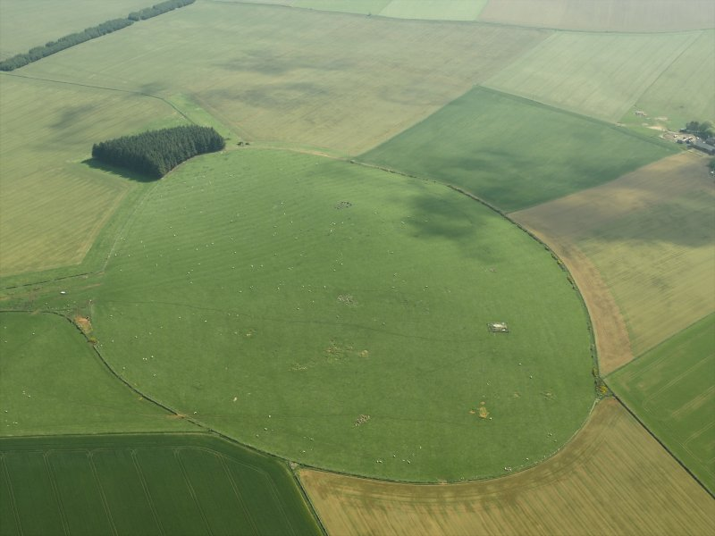 General oblique aerial view centred on the remains of the recumbent stone circle and rig, taken from the NW.