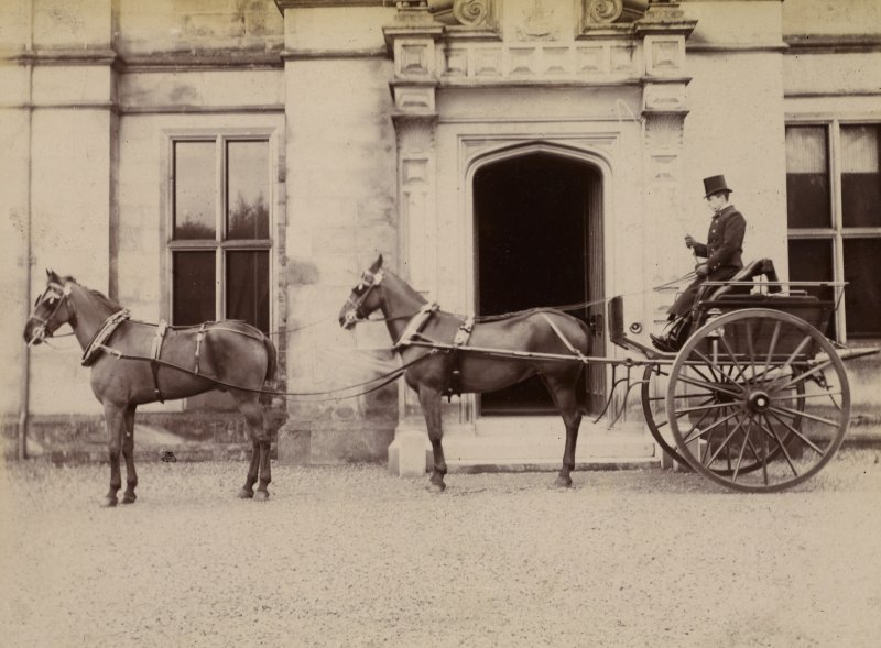 View of carriage with coachman and two horses outside St Fort House.