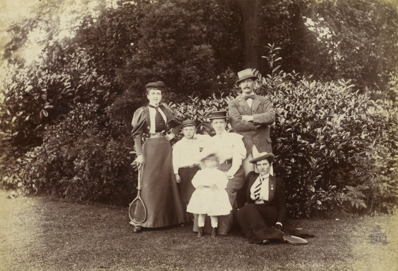 View of group of six people possibly in the garden at St Fort House.
