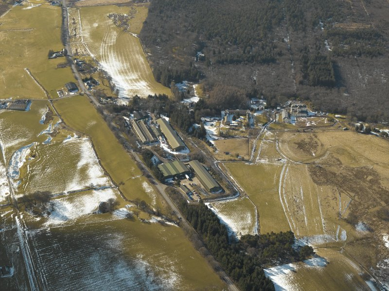 Oblique aerial view of the country house, the chicken sheds and the remains of the gardens, taken from the ENE.