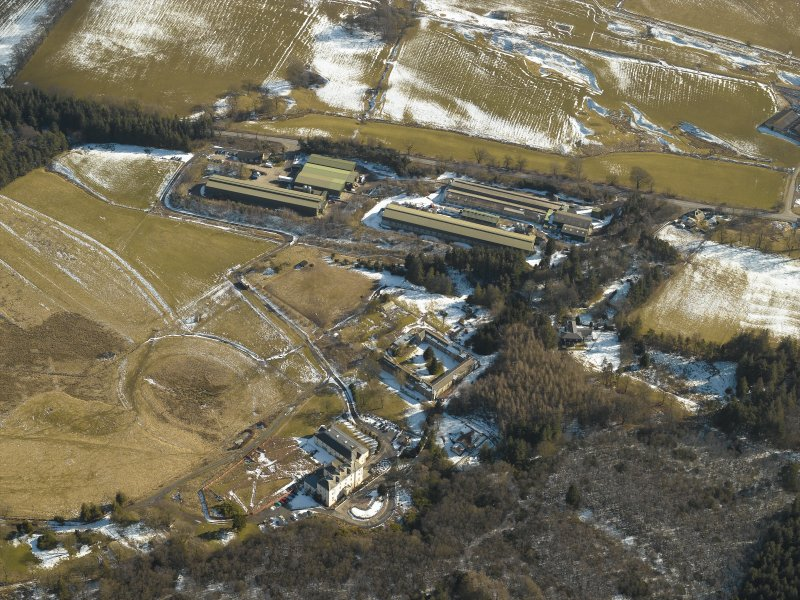 General oblique aerial view of the country house, the chicken sheds and the remains of the gardens, taken from the .