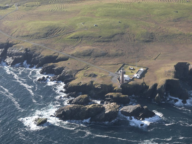 Oblique aerial view centred on the lighthouse and buildings, taken from the NE.