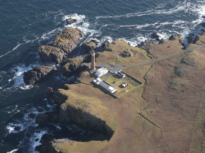 Oblique aerial view centred on the lighthouse and buildings, taken from the WSW.