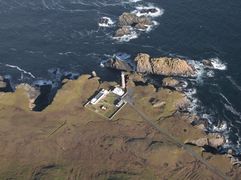 Oblique aerial view centred on the lighthouse and buildings, taken from the SSW.