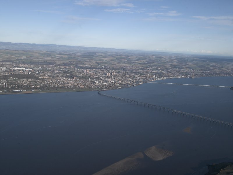 General oblique aerial view looking across the Firth of Tay, the road and rail bridges towards the city of Dundee, taken from the SW.