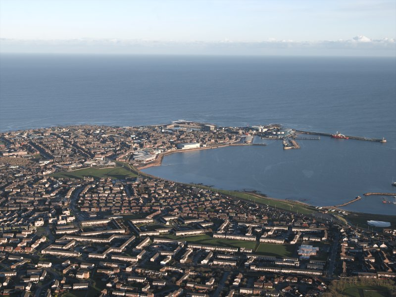 General oblique aerial view looking across Peterhead and Peterhead Bay towards the harbour and North Sea beyond, taken from the W.