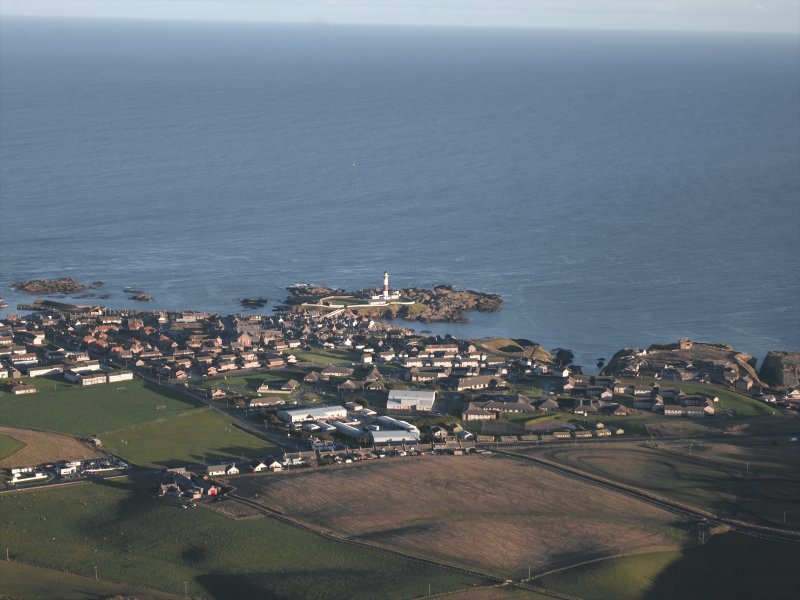 General oblique aerial view looking across the barracks, houses and village towards the lighthouse, taken from the W.
