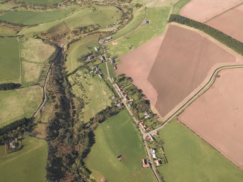 General oblique aerial view centred on the village, taken from the SE.