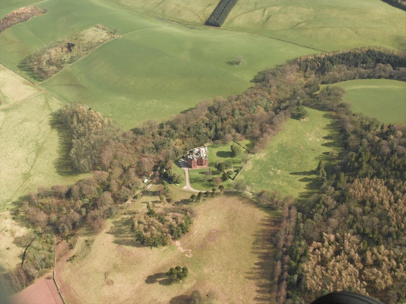 Oblique aerial view centred on the country house and towerhouse, taken from the WNW.