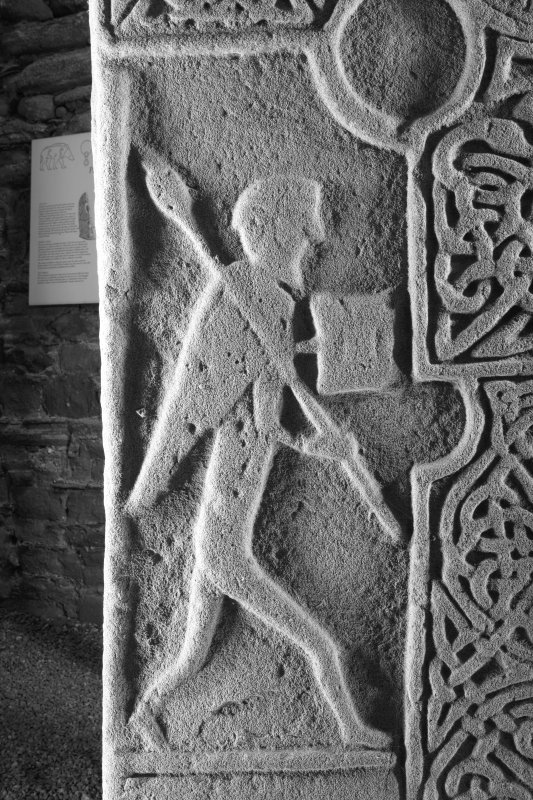 Face A. detail showing figure carrying spear (B&W)