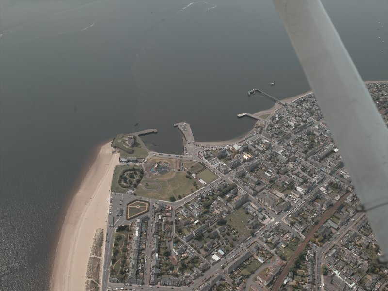 General oblique aerial view of Broughty Ferry, the castle and harbour, taken from the NE.