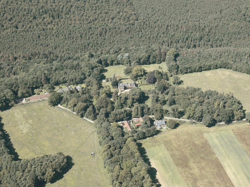 Oblique aerial view of the country house and policies, taken from the SE.