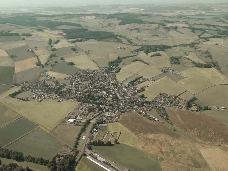 General oblique aerial view of the village, taken from the SE.
