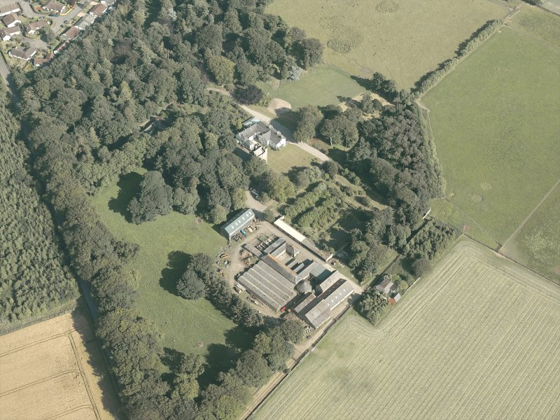 Oblique aerial view of the country house and farmsteading, taken from the NW.