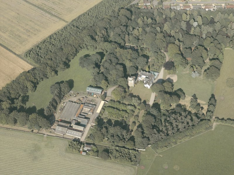 Oblique aerial view of the country house and farmsteading, taken from the WSW.