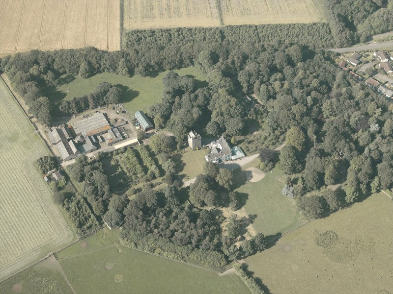 Oblique aerial view of the country house and farmsteading, taken from the SSW.