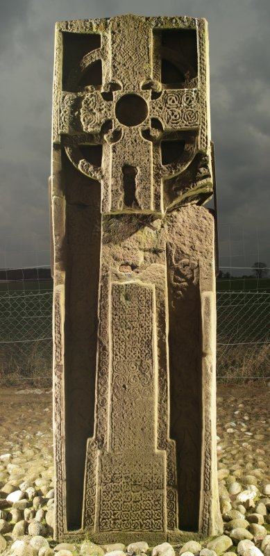 View of front face of slab with full length cross and interlace patterns, obliqely lit