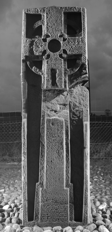 View of front face of slab with full length cross and interlace patterns (B&W), obliqely lit