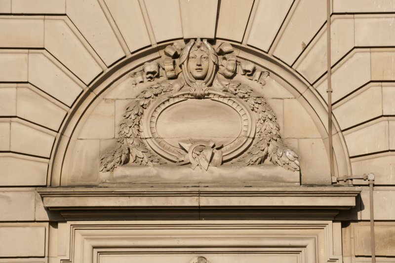 Detail of carved tympanum above doorway on Grindlay Street facade
