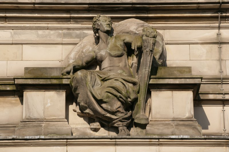 Detail of carved figure, repressenting 'Achievement',  on Grindlay Street facade