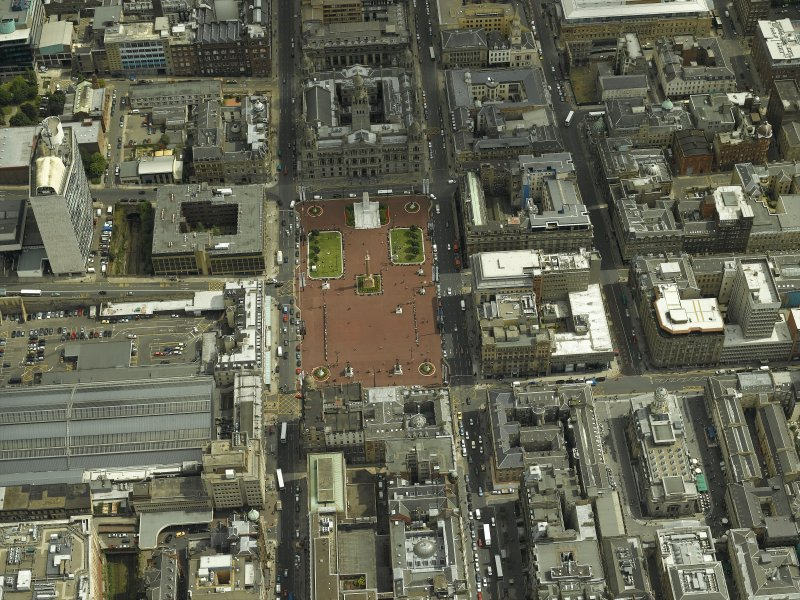 Oblique aerial view centred on George Square with the city chambers adjacent, taken from the WNW.
