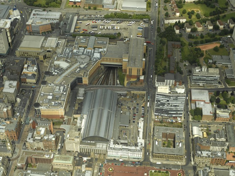 Oblique aerial view of the station and shopping centre, taken from the SSW.