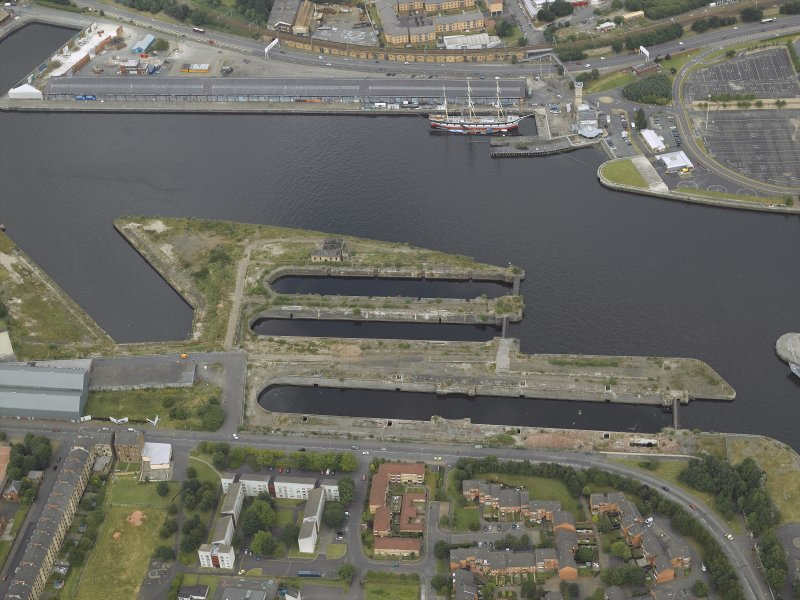 Oblique aerial view of the docks with the tall ship adjacent, taken from the SSW.