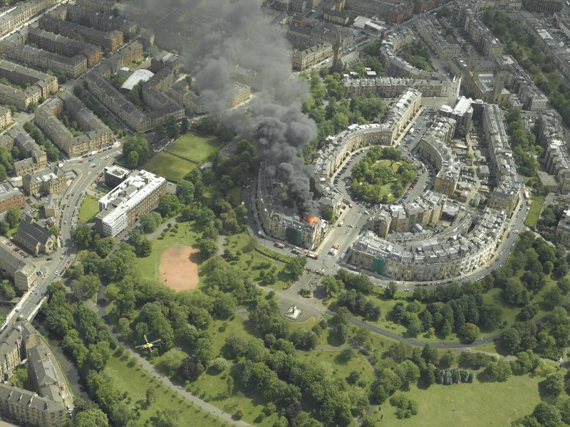 General oblique aerial view of Park Circus and the housing during the fire in Park Gate, taken from the NW.