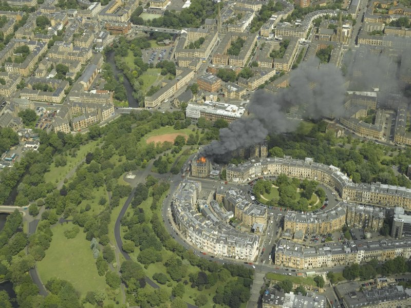 General oblique aerial view of Park Circus and the housing during the fire in Park Gate, taken from the SSW.