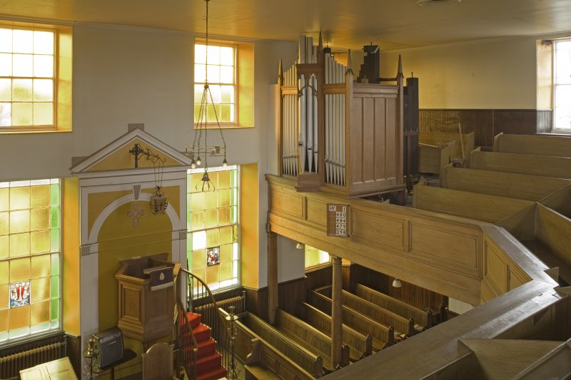 Interior. View from NE at gallery level showing pulpit and organ