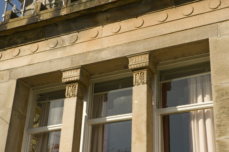 Detail of window jambs with acanthus decoration on ground floor window on E facade