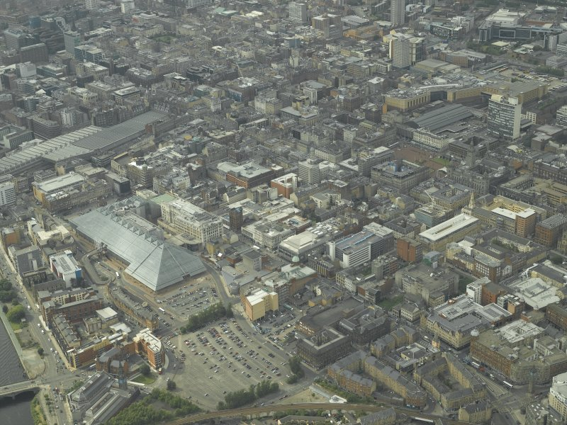 General oblique aerial view of the city centre with the shopping centre in the foreground, taken from the SE.