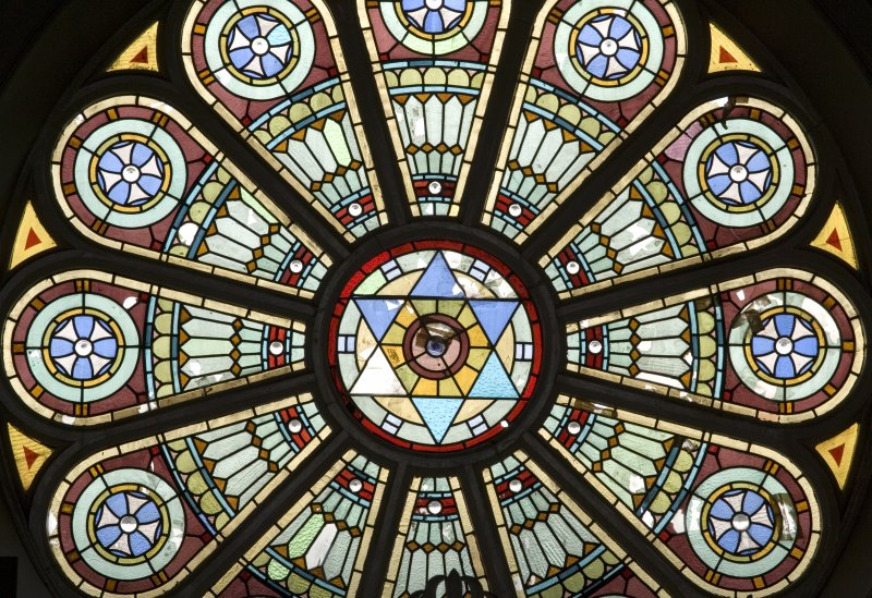 Interior. Detail of W stained glass rose window
