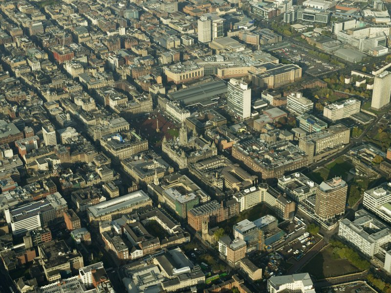 General oblique aerial view of the square, shopping centre, station and city chambers, taken from the SE.