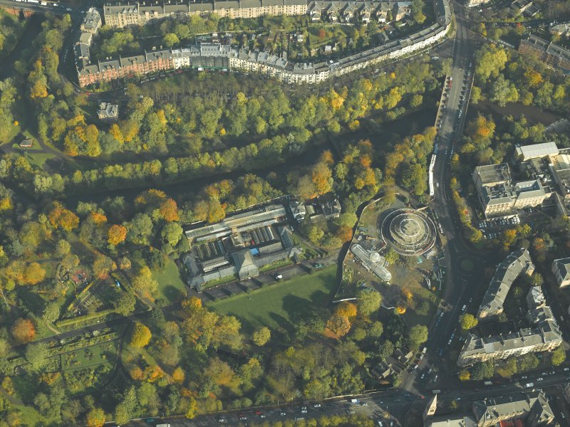 Oblique aerial view of the botanic gardens and glasshouses with the conservatory under renovation, taken from the SSW.