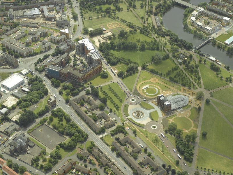 General oblique aerial view of Glasgow Green, the museum and factory, taken from the N.