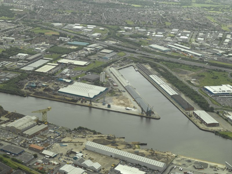 Oblique aerial view centred on the dock, taken from the NNE.