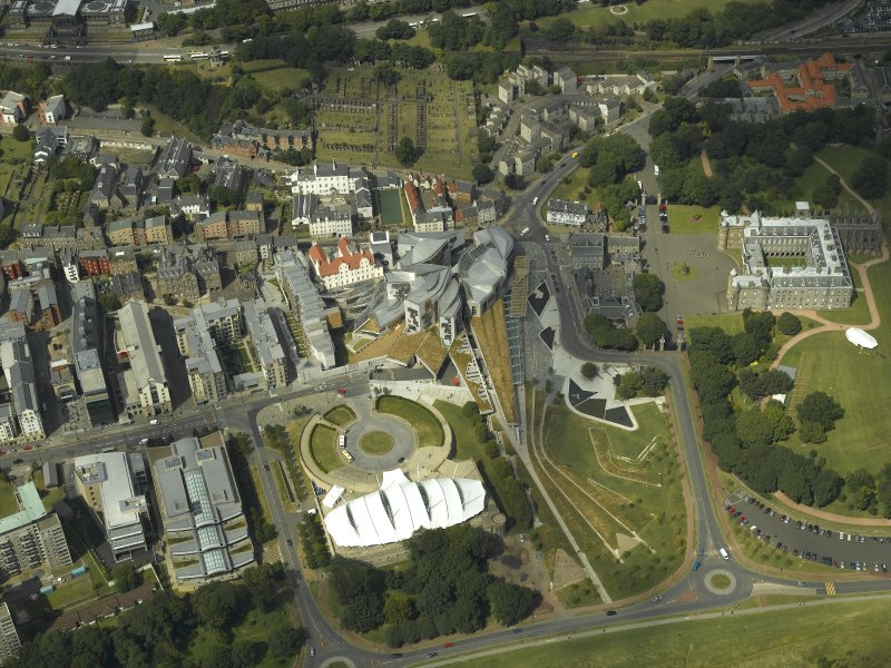 Oblique aerial view centred on the Scottish Parliament with the exhibition centre and palace adjacent, taken from the SSE.