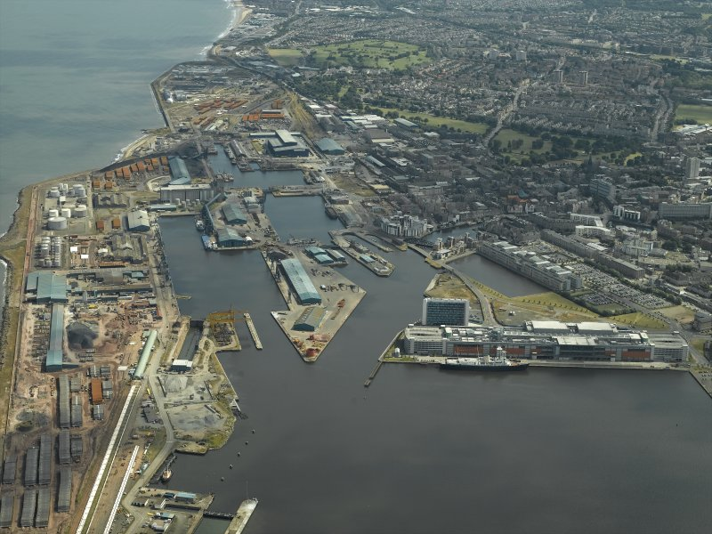 General oblique aerial view of the docks, taken from the NW.