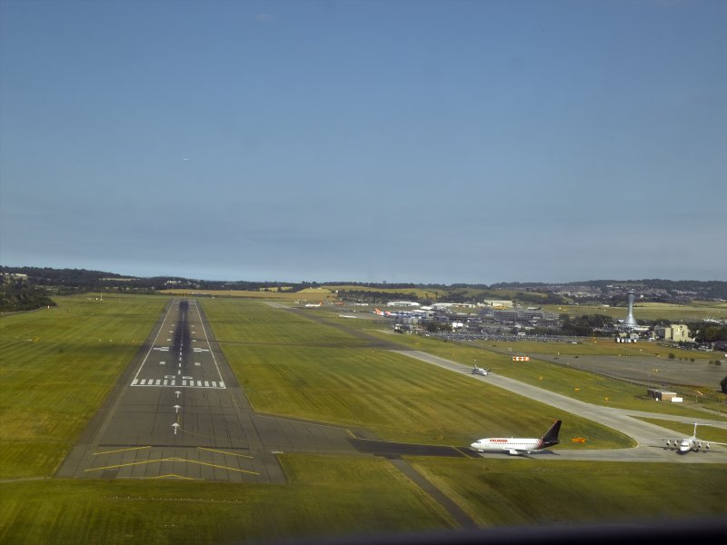 Oblique aerial view of the runway at the airport while coming in to land, taken from the SW.
