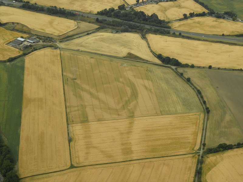 Oblique aerial view centred on the linear cropmarks, taken from the E.