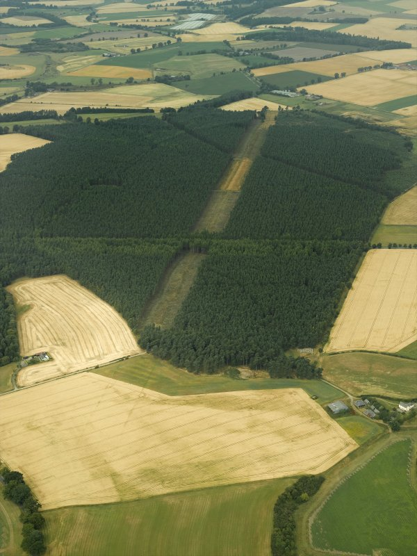 Oblique aerial view centred on the cropmarks and the remains of the Cleaven Dyke cursus monument, taken from the ESE.
