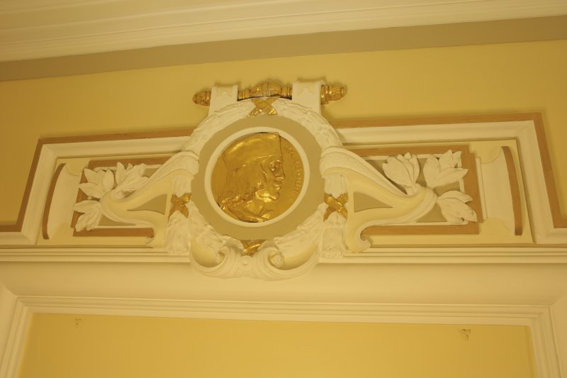 Interior. Ground floor, corridor, pediment with roundel (Barbour)