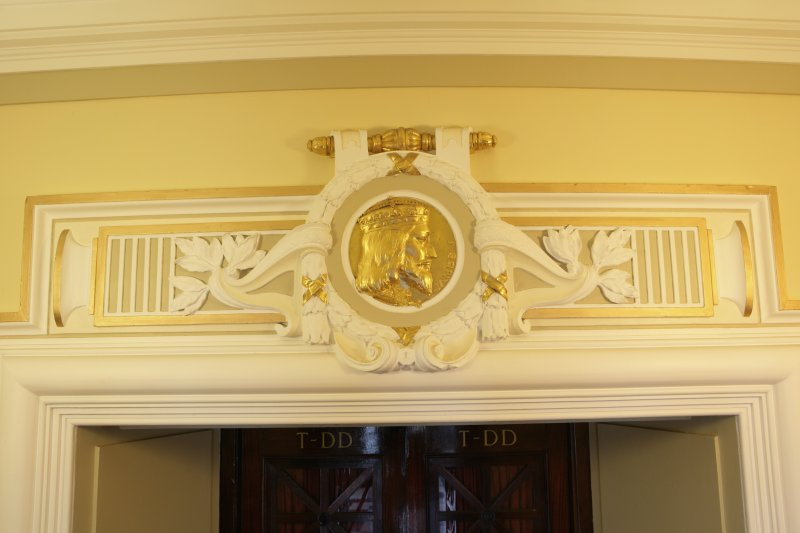 Interior. Ground floor, corridor, view of pediment with roundel (James I of Scotland)