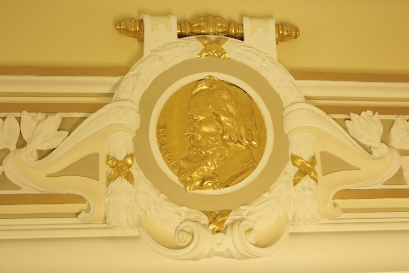 Interior. Ground floor, corridor, detail of roundel (Brahms)