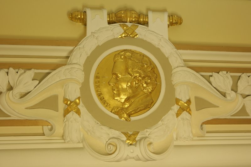 Interior. 1st floor, corridor, detail of roundel (Schubert)