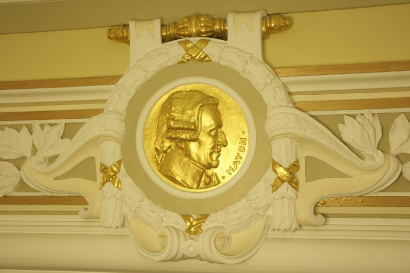 Interior. 1st floor, corridor, detail of roundel (Haydn)