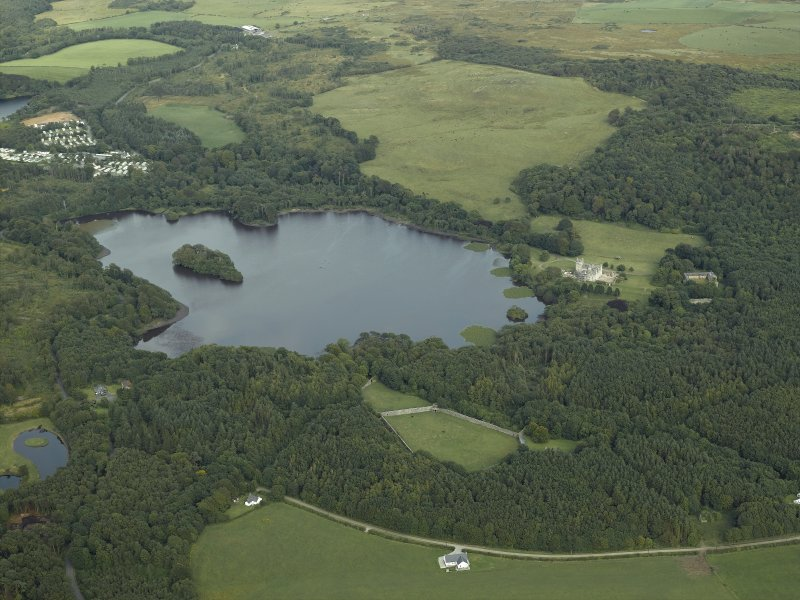 General oblique aerial view centred on Lochnaw Loch and towerhouse, with the towerhouse and country house adjacent, taken from the WNW.