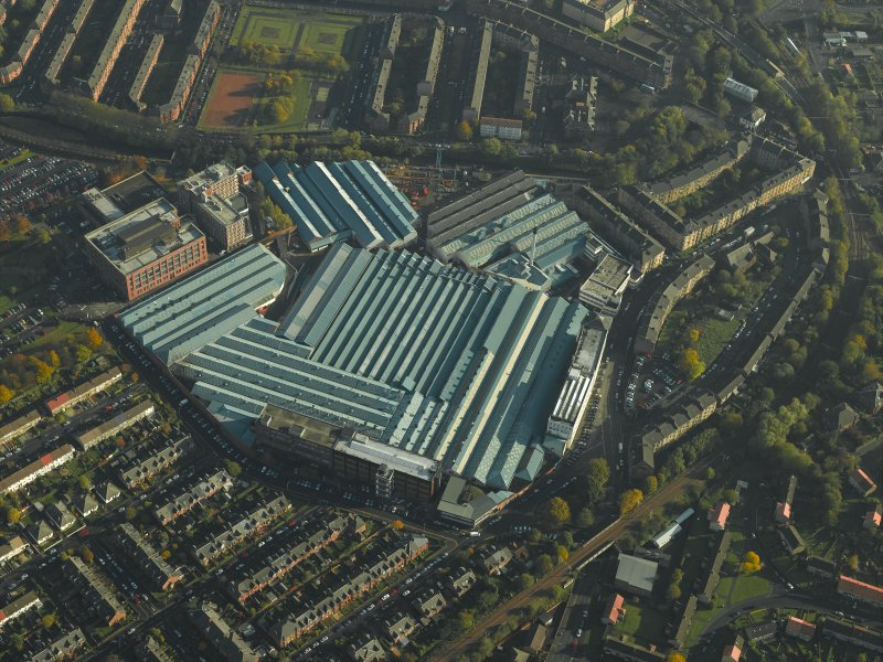 Oblique aerial view centred on the engineering works with the workshops adjacent, taken from the W.